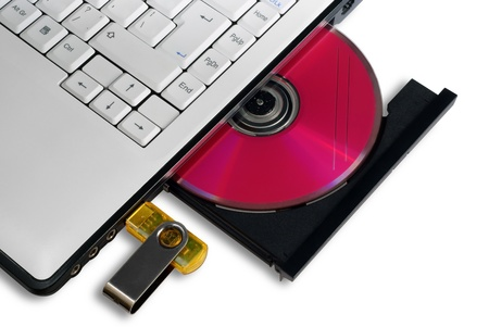 laptop with open DVD tray and usb flash drive