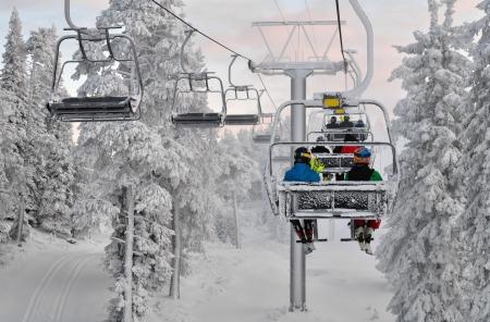 Ski chair lift with skiers  Ski resort in Ruka, Finland