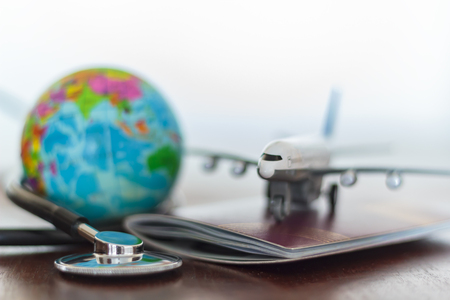 Photo pour Healthcare and travel insurance concept. Stethoscope , passport document, airplane and globe - image libre de droit
