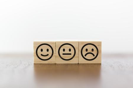 Photo pour Smiley face, neutral face and sad face. Service rating and costumer satisfaction concept - image libre de droit