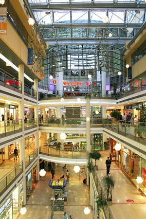 PRAGUE - JULY 07: Vertical oriented image of Palac Flora shopping mal interior. Palac Flora mall was opened in 2003, contains 4 floors and filled with 120 shops, food court, Cinema City theaters and IMAX. This is one of the largest malls in Prague, Czech