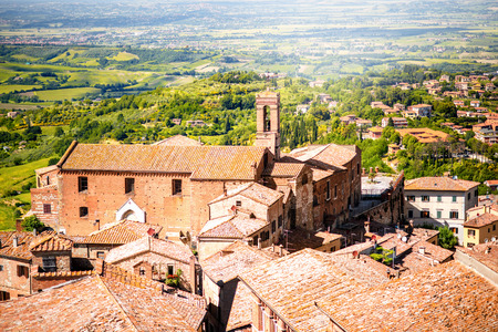 Montepulciano cityscape view on the old buildings and Saint Agostino church in Tuscany region in Italy