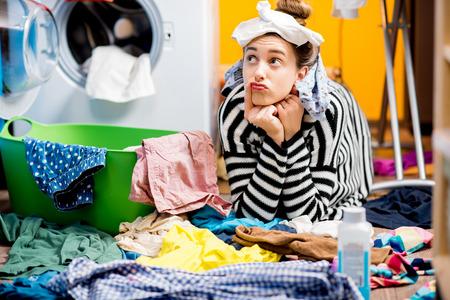 Photo pour Woman washing clothes at home - image libre de droit
