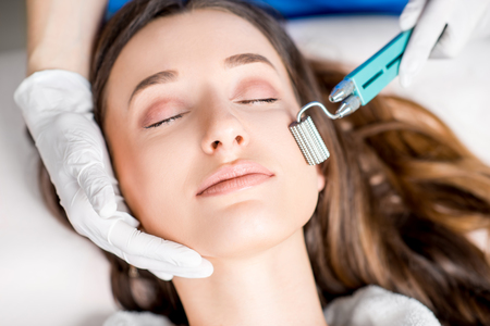 Photo for Womans facial treatment - Royalty Free Image