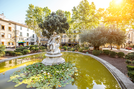 View on the small green fountain in Nimes city in the Occitanie region of southern France