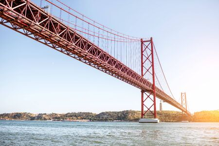 Landscape view on the 25th of April Bridge during the sunset in Lisbon city, Portugal