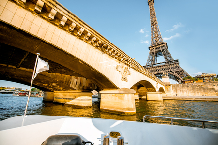 Foto de View from the boat on the Eiffel tower on Seine river during the sunset in Paris - Imagen libre de derechos