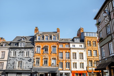 Foto per Beautiful facades of the old buildings in the central square in Honfleur, famous french town in Normandy - Immagine Royalty Free