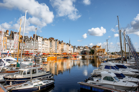 Landscape view of the harbour in Honfleur, famous french town in Normandy, during the morning light