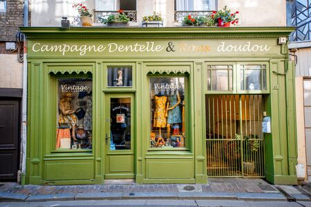Foto de HONFLEUR, FRANCE - September 06, 2017: Street view with beautiful store front with clothes in Honfleur old town, normandy region in France - Imagen libre de derechos