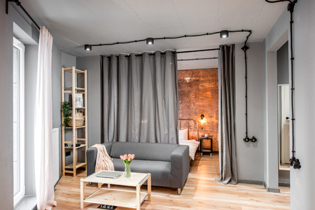Modern living room in loft style made in grey colors with ...