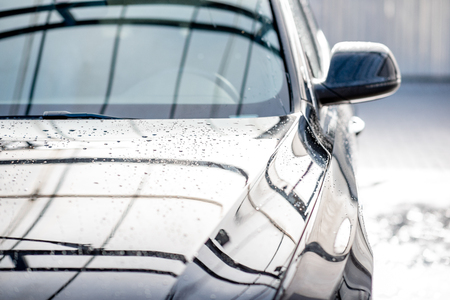 Photo for Close-up of a clean car with water dropes after the washing - Royalty Free Image
