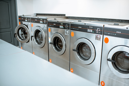 Photo for Professional washing machines at the self-service laundry - Royalty Free Image