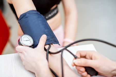 Close-up of a blood pressure measuring process