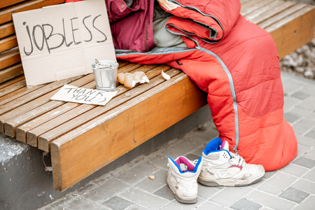 Photo for Jobless beggar with cardboard and cup begging some money, close-up view with no face - Royalty Free Image