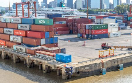 Photo for Buenos Aries / Argentina - January 19, 2020. Cargo containers moved by cranes are stacked around Puerto Madero awaiting shipping to other countries . - Royalty Free Image