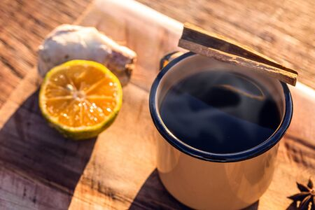 Photo for typical Brazilian drink, consumed in an enameled mug in winter and June or July parties. Ginger, with cinnamon, cachaça and lemon. - Royalty Free Image