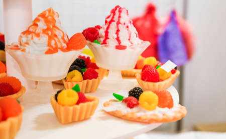 Photo pour Collection of soap in the form of ice cream, cake and other sweets. Horizontal photo - image libre de droit