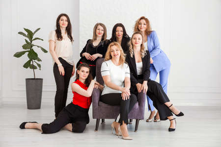 Photo pour Happy women work team employees group looking at camera posing in studio, smiling women company staff workers, workforce members, business people managers standing together, portrait. Horizontal photo - image libre de droit