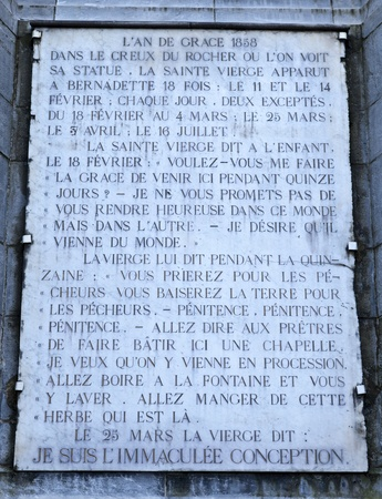 Plaque recalling the story of the Sanctuary of Lourdes, France