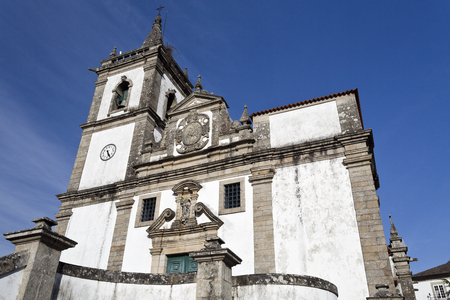 The facade of the parish church of Sao Joao Baptista combines the Mannerist and Baroque styles and a prominence of the Baptism of Christ, in Ponte da Barca, Portugal