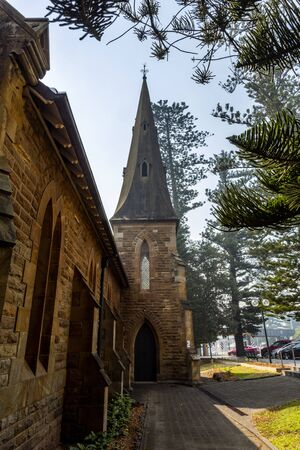 View of the bell tower of the magnificent Kiama Scots Presbyterian Church, built in 1863 in early English architecture using sandstone quarried nearby, in Kiama, South Coast of New South Wales