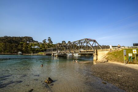 Photo pour View from the south east of the road bridge over the Wagonga Inlet, completed in 1931 in Narooma, South Coast of New South Wales, Australia - image libre de droit