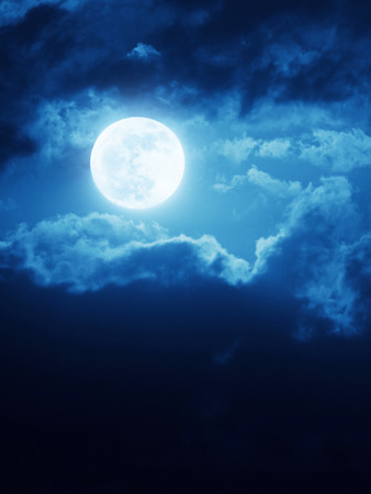 This dramatic moonrise with deep blue night time sky and clouds make a great magical or romantic background