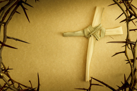 Easter Cross Of Palm Branch Surrounded By Crown Of Thorns