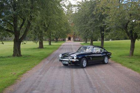 British classic sports car 1960s 60s black Triumph GT6 Spitfire