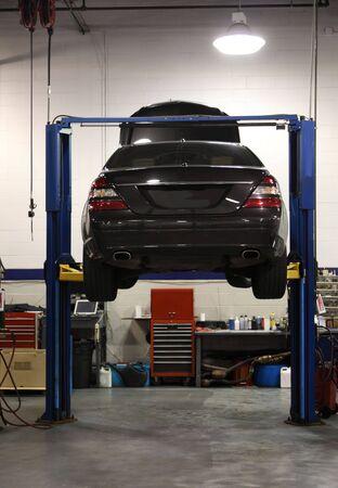 Photo pour Automobile on a lift for servicing and repair - image libre de droit