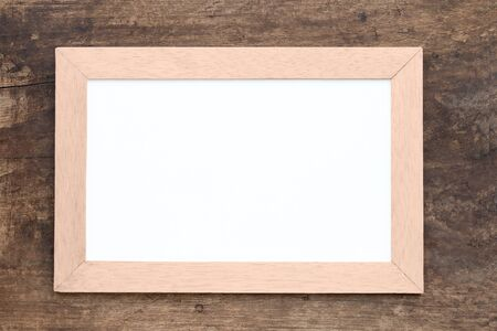 Blank Whiteboard on wood background