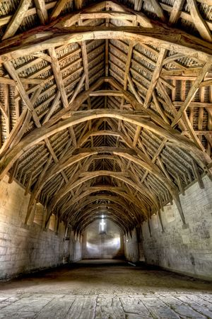 The Tithe Barn was built in the early 14th century as part of the medieval farmstead belonging to Shaftesbury Abbey.  Its function was to store the produce of the farm, and of the farms of the manor. Tenant farms contributed a tithe, meaning a tenth of th