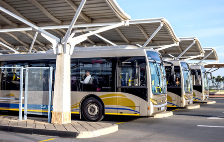 Photo for Pretoria, South Africa - March 6, 2018: Public busses waiting in depot. - Royalty Free Image