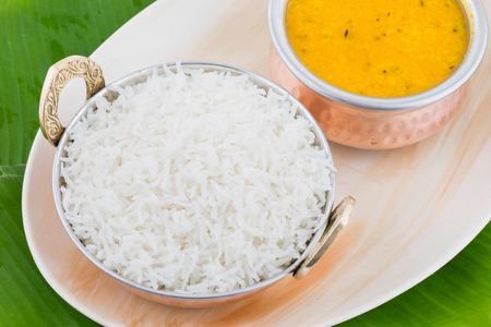 Indian Traditional Cuisine Dal Fry or Rice Also Know as Dal Chawal, Daal Chawal, Dal Rice, Whole Yellow Lentil with Rice or Dal Tadka, Daal Fry Served with Rice on Banana Leaf
