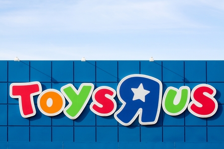 Aarhus, Denmark - June 21, 2015: Logo of the brand Toys r us.  Toys r us is an American toy and juvenile products retailer.