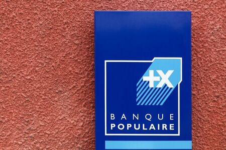 Beaujeu, France - June  20, 2016: Banque Populaire sign on a wall. Banque Populaire is a French group of cooperative banks