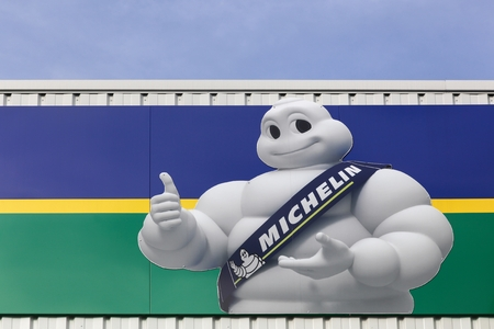 Villefranche, France - February 12, 2017: Michelin logo on a wall. Michelin is a tire manufacturer based in Clermont-Ferrand in France and it's one of the three largest tire manufacturers in the world