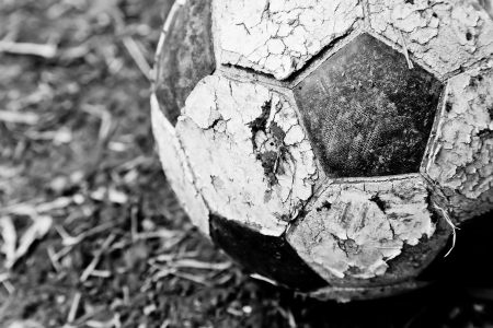 The closeup image of an old ball on the ground