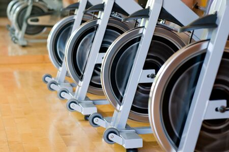 Row of spinning wheels in a modern gym