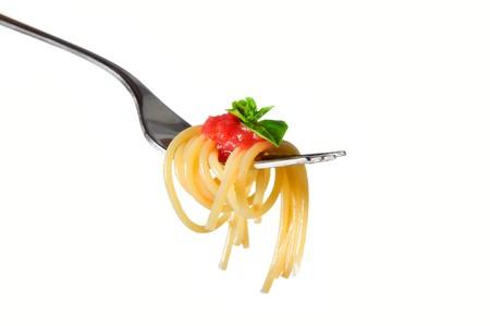 Spaghetti pasta with tomato and basil on fork isolated on white background. Fine Italian food. Professional studio image