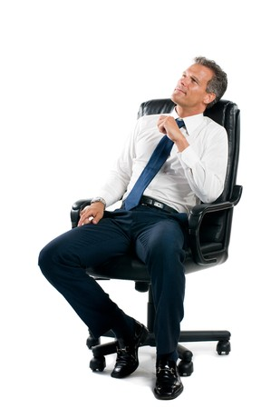 Dreamful pensive businessman sit on his business chair isolated on white background