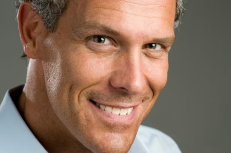 Close up portrait of smiling handsome mature man