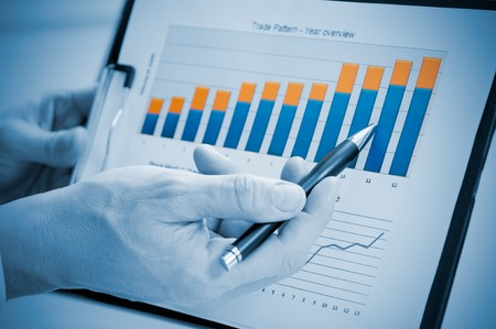 Businessman hand showing growing chart on annual report, good business growth