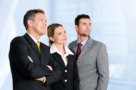Smiling confident business team looking away at their bright future