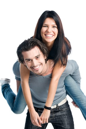 Happy young latin couple smiling and playing piggyback isolated on white background
