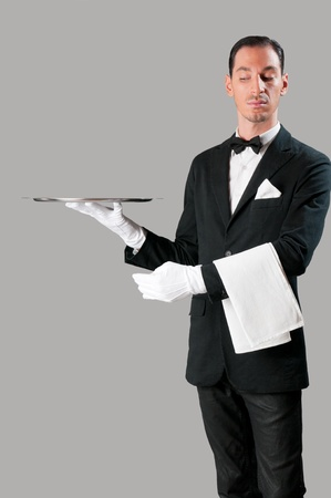 Haughty waiter holding an empty tray to place your product
