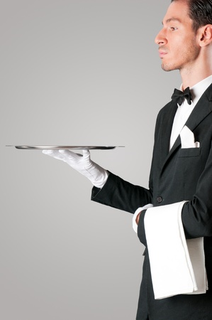 Proud waiter holding an empty tray to place your product