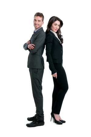 Smiling business couple standing together isolated on white backgroundの写真素材