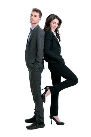 Foto de Proud successful business couple looking at camera isolated on white background - Imagen libre de derechos
